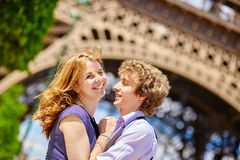Happy couple in Paris under the Eiffel tower Stock Photos