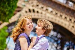 Happy couple in Paris under the Eiffel tower Stock Photos