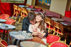 Happy couple in a Parisian outdoor cafe Royalty Free Stock Images