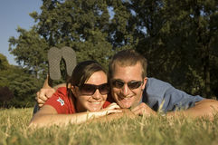 Happy couple in the park. Happy couple relaxing in the park in summer royalty free stock photo