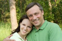 Happy couple in a park Stock Images
