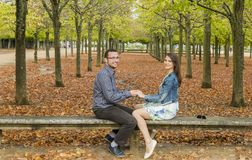 Happy Couple in a Park in Autumn Royalty Free Stock Photography