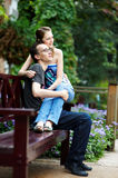 Happy couple on park bench Royalty Free Stock Photo