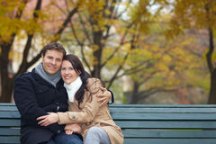 Happy couple on park bench Stock Photo