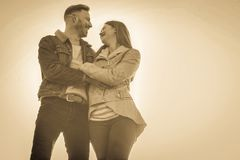 Happy couple in the park. Happy couple walking through the park. royalty free stock images