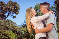 Happy couple in the park Royalty Free Stock Photo