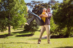 Happy couple in the park Stock Image