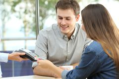 Couple paying with credit card in a bar stock images