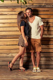 Happy couple in photo shooting outdoor on wooden background Royalty Free Stock Images