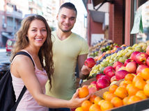 Happy couple picking fruits Royalty Free Stock Images