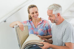 Free Happy Couple Picking Out Carpet Samples Together Stock Photo - 39233450