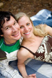 Happy Couple Picnic. A portrait of a smiling happy couple outdoors on a picnic blanket stock image
