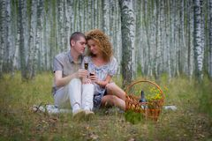 Happy couple on picnic in forest Royalty Free Stock Photos