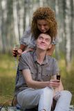 Happy couple on picnic in forest Stock Images