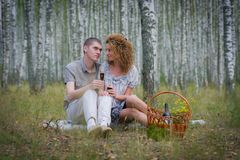 Happy couple on picnic in forest Royalty Free Stock Photography