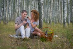 Happy couple on picnic in forest Royalty Free Stock Images