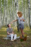 Happy couple on picnic in forest Stock Photo