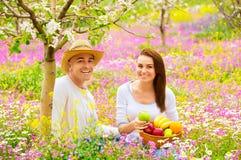 Happy couple on picnic in garden Royalty Free Stock Photos