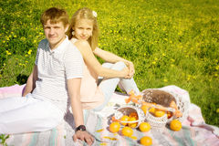 Happy couple and picnic with oranges Stock Photo