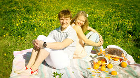 Happy couple and picnic with oranges Stock Photos