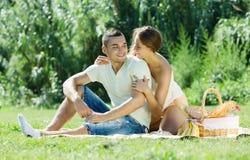 Happy couple on picnic stock photo