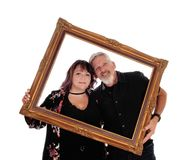 Happy couple in a picture frame Stock Images