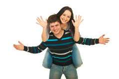 Happy couple in piggy back Stock Photography