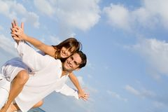 Happy couple piggyback Royalty Free Stock Images