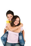 Happy couple in piggyback Royalty Free Stock Images