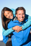 Happy couple piggyback in active lifestyle Royalty Free Stock Images