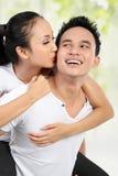 Happy couple piggyback ride Royalty Free Stock Image