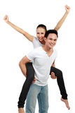 Happy couple piggyback ride Royalty Free Stock Images