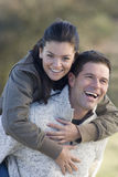 Happy couple piggybacking stock photos