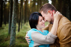 Happy couple in a pine forest Stock Photos