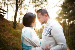 Happy couple in a pine forest Stock Images