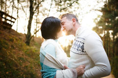 Happy couple in a pine forest Stock Photo
