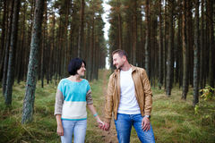 Happy couple in a pine forest Royalty Free Stock Photo