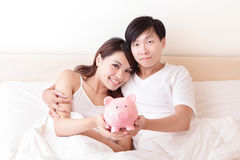 Happy couple with pink piggy bank Royalty Free Stock Images