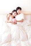 Happy couple with pink piggy bank Royalty Free Stock Photo
