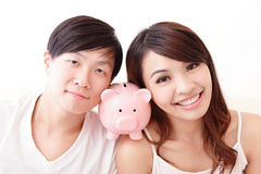 Happy couple with pink piggy bank Stock Photo