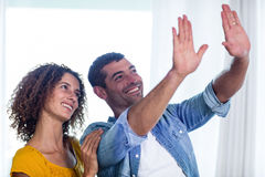 Happy couple planning and gesturing Stock Photography