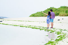 Happy couple play on the beach, Stock Images