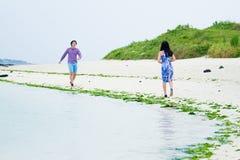 Happy couple play on the beach, Royalty Free Stock Photo