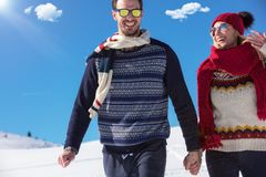 Happy couple playful together during winter holidays vacation outside in snow park Stock Images