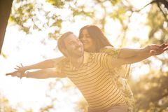 Happy couple playfully at spring season. Beauty in nature royalty free stock images