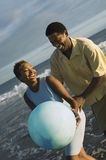 Happy Couple Playing With Beach Ball. African American couple playing with beach ball Royalty Free Stock Images