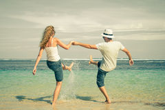 Happy couple playing on the beach Royalty Free Stock Images