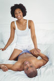Happy couple playing on the bed Royalty Free Stock Image
