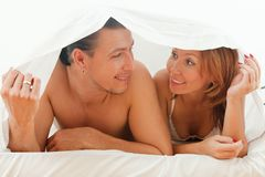 Happy couple playing in bed Royalty Free Stock Image