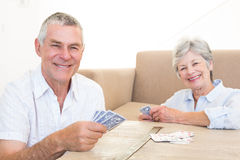 Happy couple playing cards Royalty Free Stock Photos